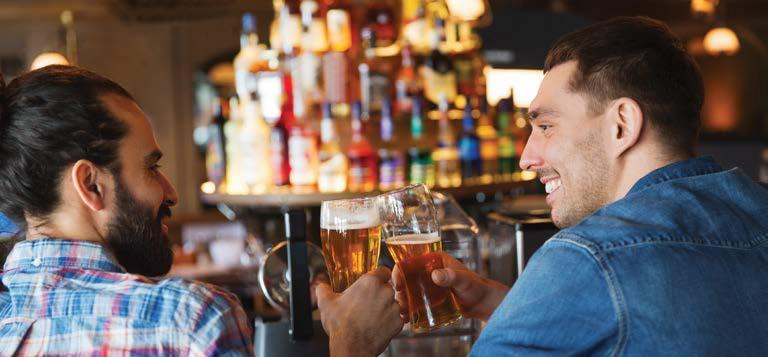 Men laughing at bar